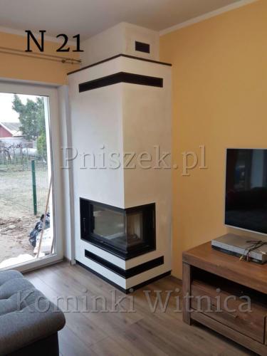 kominek zbudowany na bazie wkładu zibi 12 z ramka z czarnego granitu kominek zbudowany w Swiebodzin